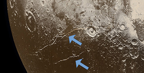 Extensional faults (arrows) on the surface of Pluto indicate expansion of the dwarf planet's icy crust, attributed to freezing of a subsurface ocean. (Image credit: NASA/Johns Hopkins University Applied Physics Laboratory/Southwest Research Institute/Alex Parker)