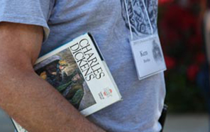 Photo of man with Charles Dickens' literature