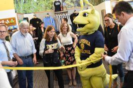 Campus mascot Sammy the Slug and Bookshop Santa Cruz staff at the grand opening of the UC Santa Cruz Slug Shop