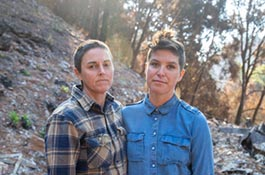 Kristen Lee, sustainability programs manager (right), with wife Josette Kniffen. Their cabin on 11 acres on Swanton Road burned to the ground in the CZU August Lightning Complex fires. —Photo by Carolyn Lagattuta