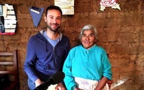 Maziar Toosarvandani, associate professor of linguistics, recording traditional narratives with a Zapotec elder in Santiago Laxopa, Oaxaca, Photo by Fe Silva Robles